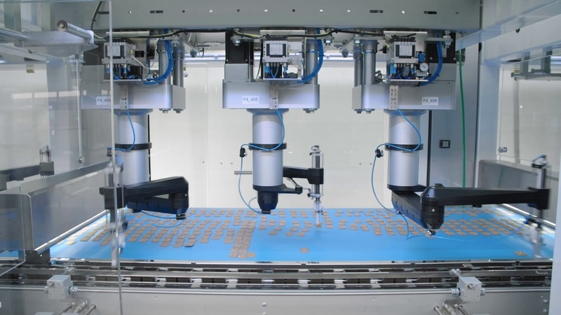 Pick and place packaging line from Schubert loads biscuits into trays